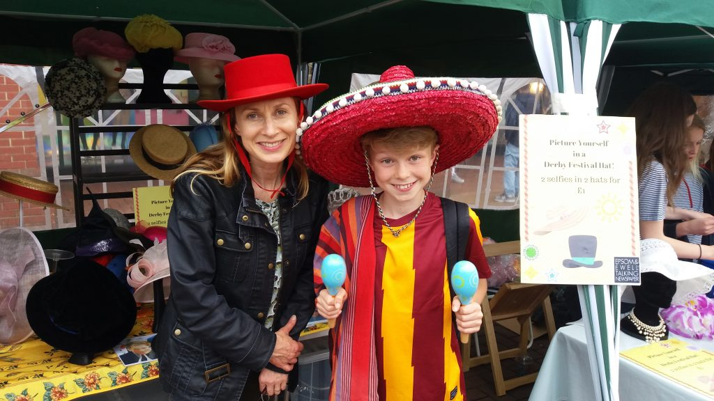 Photograph of Maria Reeves, Director of Epsom and Ewell Arts Festival with her son who is wearing a sombrero