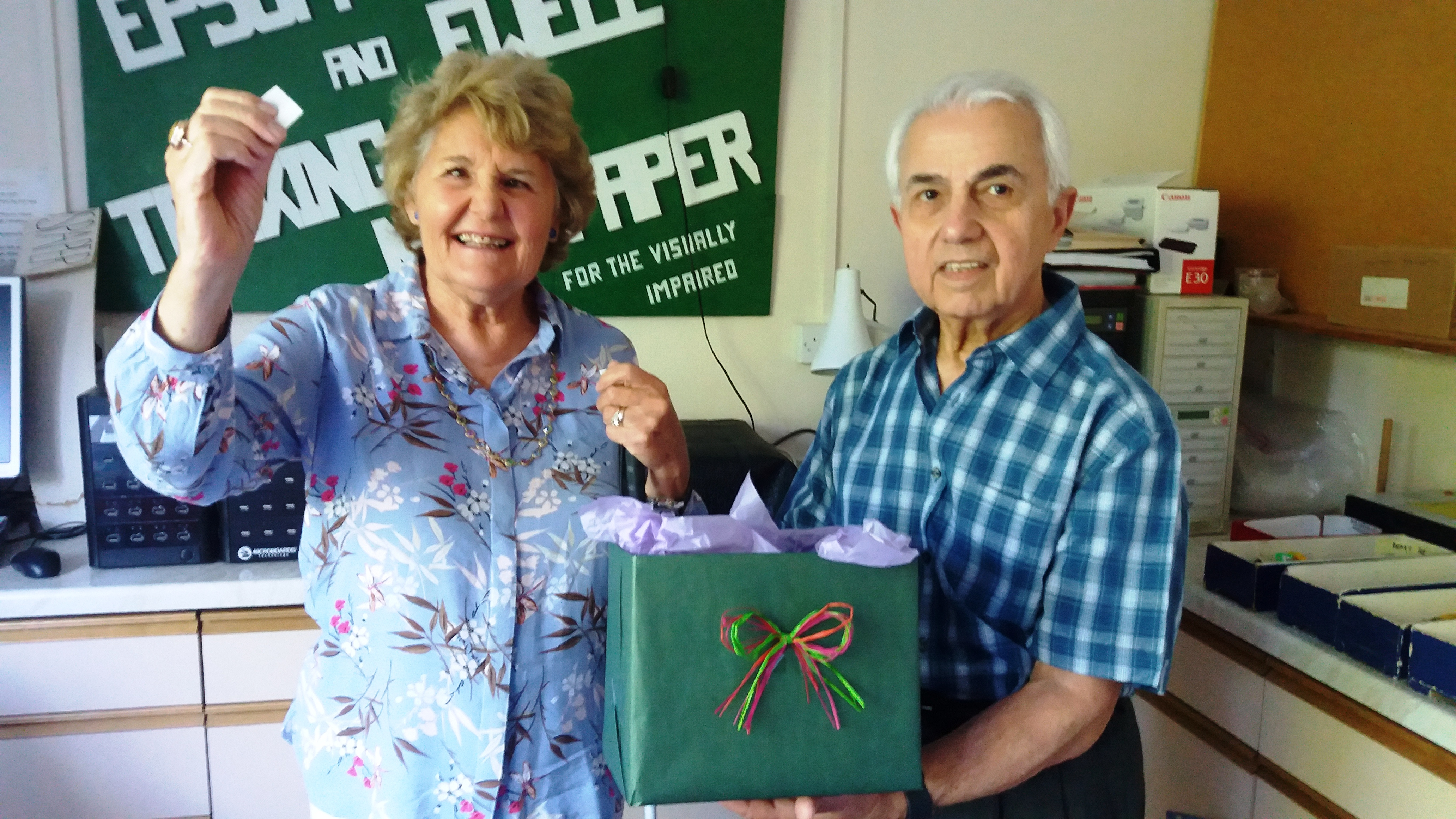 Chairman Judy Sarssam with husband Amer draw the winning numbers