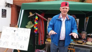 Photograph of Paul Sonnex doing a Tommy Cooper impression