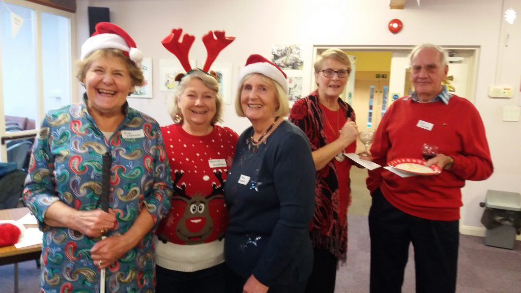Judy Sarsson and volunteers at the Christmas party 2019