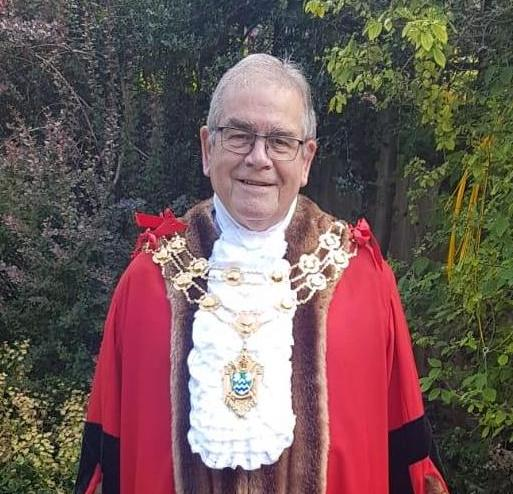 A picture of the mayor in his robes of office